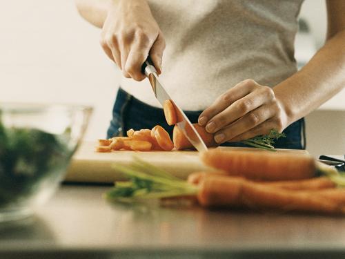 01-woman-chopping-vegetables-cutting-board-kitchen-lgn.jpg